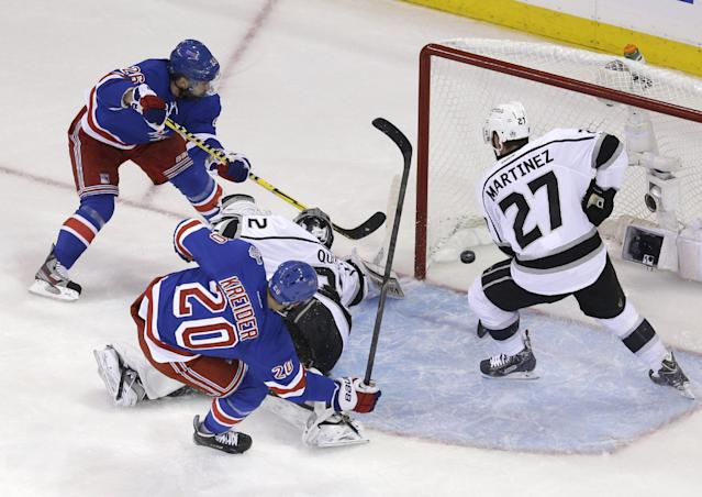 While New York Rangers left wing Chris Kreider (20) looks on, New York Rangers right wing Martin St. Louis (26), left, scores past Los Angeles Kings defenseman Alec Martinez (27), right, and Los Angeles Kings goalie Jonathan Quick (32) in the second period during Game 4 of the NHL hockey Stanley Cup Final, Wednesday, June 11, 2014, in New York. (AP Photo/Seth Wenig)