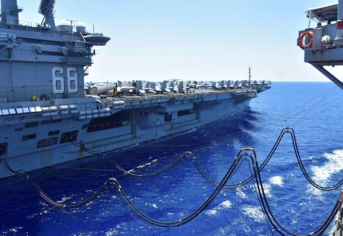 Image: The U.S. Navy aircraft carrier USS Nimitz receives fuel during operations in the South China Sea in July. (US NAVY / Reuters)