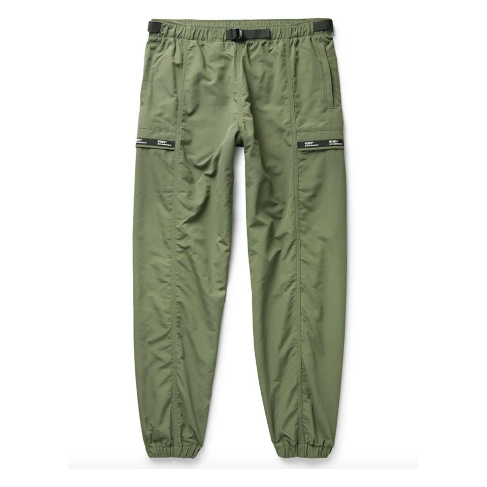 """<p><strong>WTAPS</strong></p><p>mrporter.com</p><p><strong>$290.00</strong></p><p><a href=""""https://go.redirectingat.com?id=74968X1596630&url=https%3A%2F%2Fwww.mrporter.com%2Fen-us%2Fmens%2Fproduct%2Fwtaps%2Fclothing%2Fcasual-trousers%2Ftapered-logo-appliqued-nylon-track-pants%2F29012654081146070&sref=https%3A%2F%2Fwww.esquire.com%2Fstyle%2Fmens-fashion%2Fg34645350%2Fbest-performance-pants-men%2F"""" rel=""""nofollow noopener"""" target=""""_blank"""" data-ylk=""""slk:Buy"""" class=""""link rapid-noclick-resp"""">Buy</a></p>"""