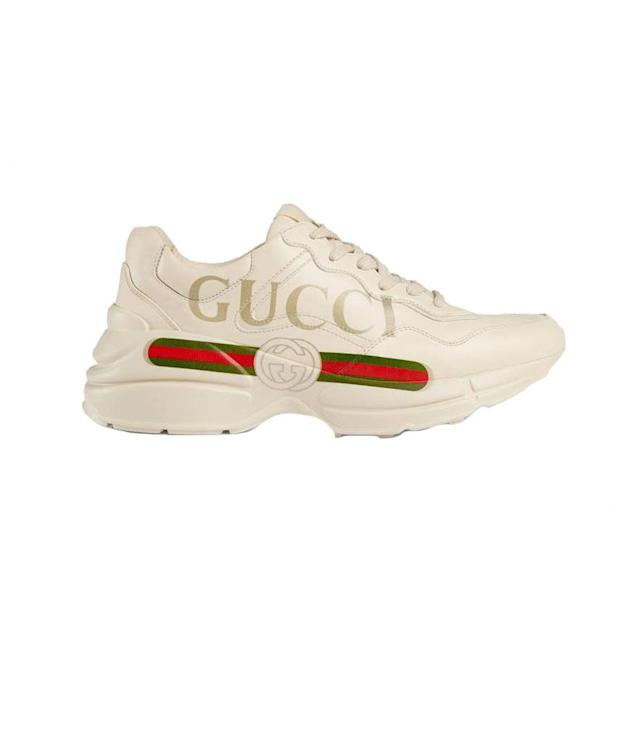 "<p>Gucci Rhyton Logo Leather Sneaker, <a href=""https://www.gucci.com/us/en/pr/women/womens-shoes/womens-sneakers/rhyton-gucci-logo-leather-sneaker-p-528892DRW009522?position=4&listName=PGUS4Cols&categoryPath=Women/Womens-Shoes/Womens-Sneakers"" rel=""nofollow noopener"" target=""_blank"" data-ylk=""slk:gucci.com"" class=""link rapid-noclick-resp"">gucci.com</a>, $850 </p>"