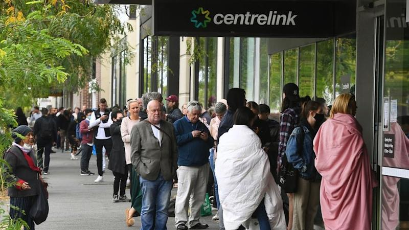 People line up for unemployment payments at a welfare office in Sydney