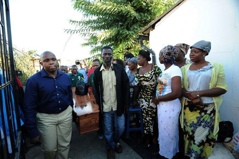 Mido Macia's coffin is carried for people to pay their last respects on March 8, 2013