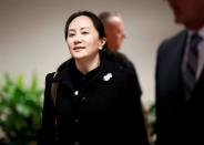 Huawei Chief Financial Officer Meng Wanzhou leaves B.C. Supreme Court for a lunch break during the first day of her extradition hearing in Vancouver