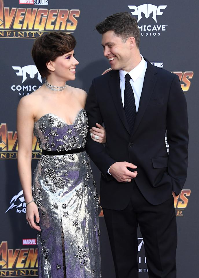 <p>The couple made their red (technically purple) carpet debut — and clearly only had eyes for each other. Scarlett is Natasha Romanoff/Black Widow in the flick. (Photo: Getty Images for Disney) </p>