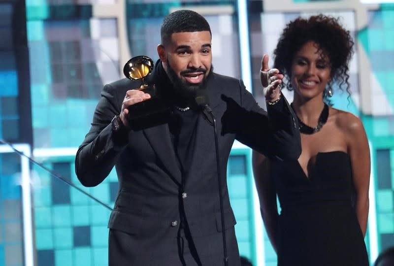 The Latest: Collaborators: No word from Glover on Grammys