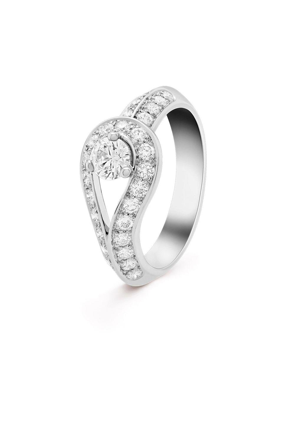 """<p><strong>Van Cleef & Arpels</strong></p><p>vancleefarpels.com</p><p><strong>$6000.00</strong></p><p><a href=""""https://go.redirectingat.com?id=74968X1596630&url=https%3A%2F%2Fwww.vancleefarpels.com%2Fus%2Fen%2Fcollections%2Fengagement%2Fengagement-rings%2Fvcard36100---couture-solitaire-platinum-round-diamond.html&sref=https%3A%2F%2Fwww.townandcountrymag.com%2Fstyle%2Fjewelry-and-watches%2Fg34777744%2Fbest-engagement-rings%2F"""" rel=""""nofollow noopener"""" target=""""_blank"""" data-ylk=""""slk:Shop Now"""" class=""""link rapid-noclick-resp"""">Shop Now</a></p><p>Van Cleef adds its own twist with this looped solitaire style. </p>"""