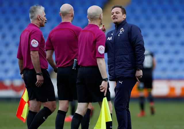 "Soccer Football - League One - Shrewsbury Town vs AFC Wimbledon - Montgomery Waters Meadow, Shrewsbury, Britain - March 24, 2018 AFC Wimbledon manager Neil Ardley confronts the officials after the game Action Images/Ed Sykes EDITORIAL USE ONLY. No use with unauthorized audio, video, data, fixture lists, club/league logos or ""live"" services. Online in-match use limited to 75 images, no video emulation. No use in betting, games or single club/league/player publications. Please contact your account representative for further details."