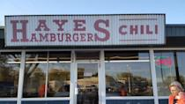 """<p><a href=""""https://www.yelp.com/biz/hayes-hamburger-and-chili-kansas-city"""" rel=""""nofollow noopener"""" target=""""_blank"""" data-ylk=""""slk:Hayes Hamburger & Chili"""" class=""""link rapid-noclick-resp"""">Hayes Hamburger & Chili</a> in Kansas City</p><p>Hayes is a tiny, yet charming neighborhood grill where you can get chili on just about anything — burgers, hot dogs, fries, tater tots and even spaghetti. The milkshakes and smash burgers with griddled onions aren't to be missed.</p>"""