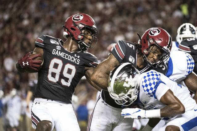 South Carolina wide receiver Bryan Edwards (89) runs with the ball behind a block by Rico Dowdle (5) against Kentucky during the first half of an NCAA college football game Saturday, Sept. 28, 2019, in Columbia, S.C. (AP Photo/Sean Rayford)