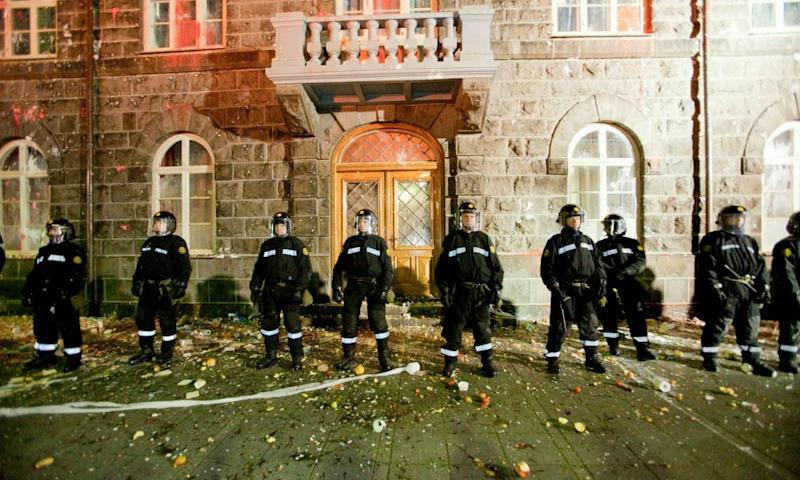 Riot police guard the Icelandic Parliament house in October 2010 after thousands protested over economic policies.