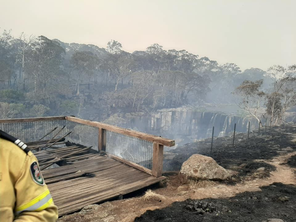 Ebor Falls, NSW, pictured during the bushfires of 2019.