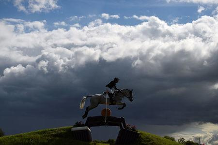 A horse and its rider jump over a hurdle in the Tattersalls International Horse trials in Ratoath, Ireland, June 3, 2017. REUTERS/Clodagh Kilcoyne