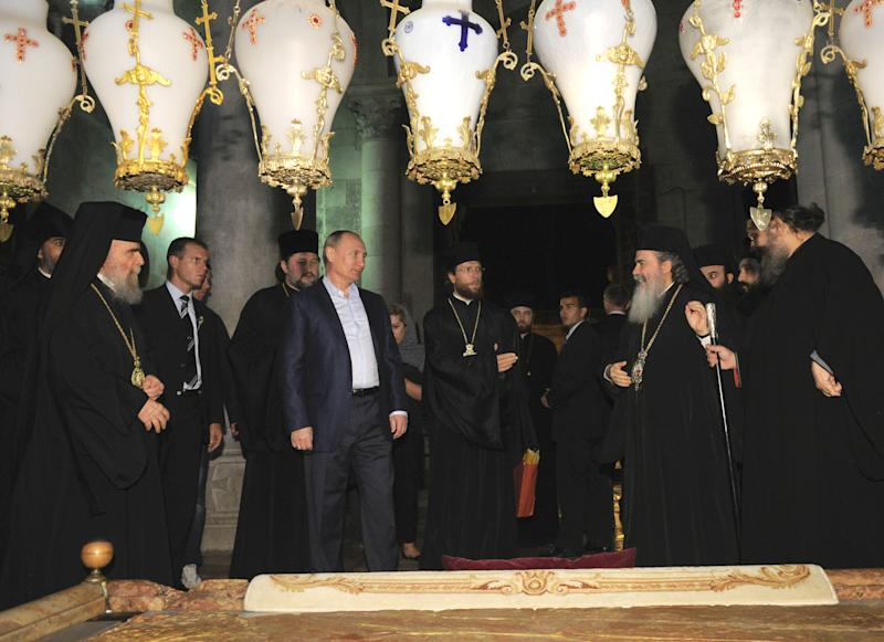 Russian President Vladimir Putin, third left, and the Patriarch of Jerusalem Theophilos III, second right, the Holy Sepulcher, in Jerusalem early Tuesday, June 26, 2012. (AP Photo/RIA-Novosti, Alexei Druzhinin, Presidential Press Service)