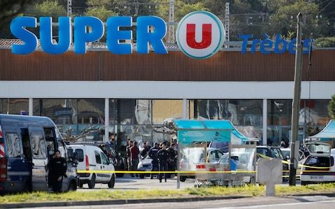 gendarmes and police officers at a supermarket after a hostage situation in Trebes - Credit: REGIS DUVIGNAU/Reuters