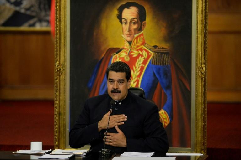 "President Nicolas Maduro insists Venezuela will never default on its debt but ratings agency Standard and Poors says the country is in ""selective default"""