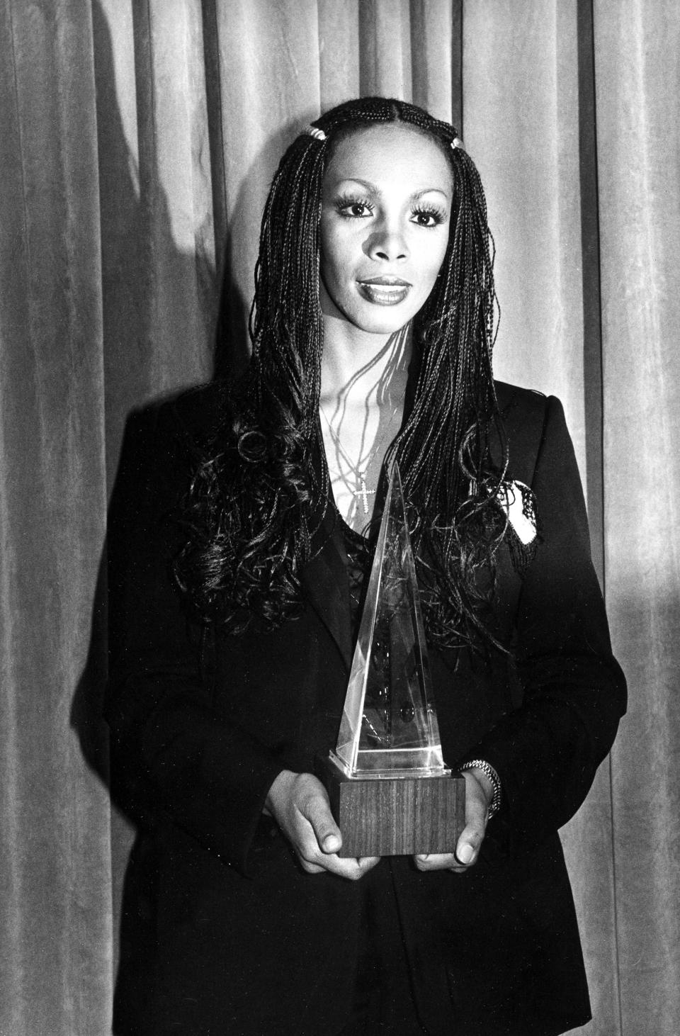 """FILE - In this Jan. 18, 1980 file photo, Donna Summer poses with her award at the American Music Awards in Los Angeles, Calif. Summer, the Queen of Disco who ruled the dance floors with anthems like """"Last Dance,"""" """"Love to Love You Baby"""" and """"Bad Girl,"""" has died. Her family released a statement, saying Summer died Thursday, May 17, 2012. She was 63. (AP Photo/Nick Ut, File)"""