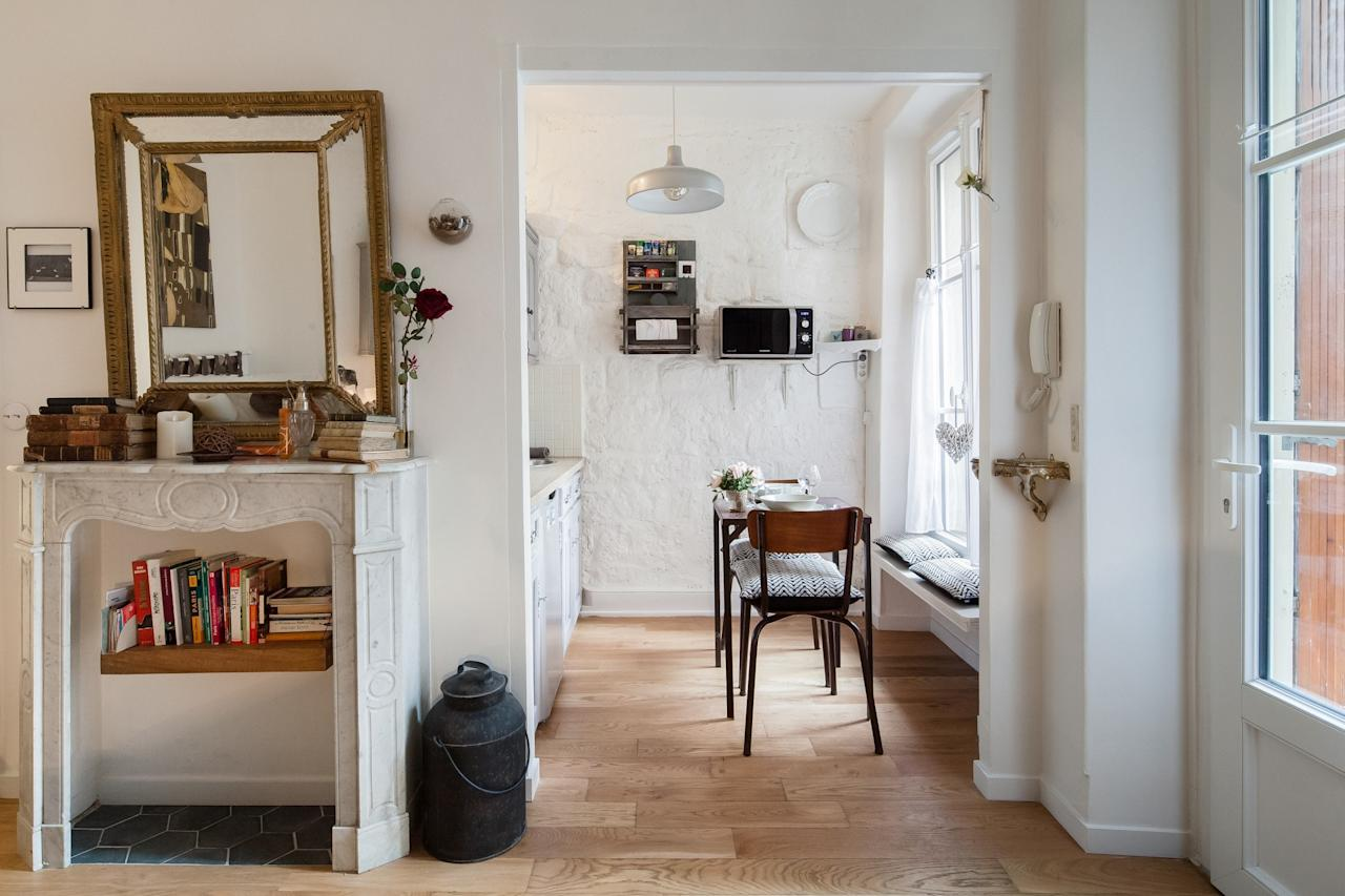 """<p>Finding accommodations for under $150 per night is nearly impossible in Paris—but this apartment on the border of the 18th arrondissement, near the <a href=""""https://www.cntraveler.com/activities/paris/basilique-du-sacre-coeur-de-montmartre?mbid=synd_yahoo_rss"""">Sacré-Coeur</a>, comes <em>very</em> close. Yes, it's a studio and a tight squeeze, but it fits everything you could need into its small space: you have a double bed, desk area, closet for hanging clothes, dining area, and kitchenette (complete with a mini-fridge, induction double burners, and a Nespresso machine). You'll also have access to the apartment's shared garden, with planters and vines and a small table to sit at while enjoying your morning coffee. As an <a href=""""https://www.cntraveler.com/story/airbnb-plus-is-for-people-who-hate-airbnb?mbid=synd_yahoo_rss"""">Airbnb Plus</a>, the apartment has passed an IRL inspection and has strong Wi-Fi, easy check-in, and toiletries like shampoo on hand so you can save space in your carry-on.</p> <p><strong>Book Now:</strong> <a href=""""https://airbnb.pvxt.net/NykE1"""" rel=""""nofollow"""" target=""""_blank"""">From $126 per night, airbnb.com</a></p>"""