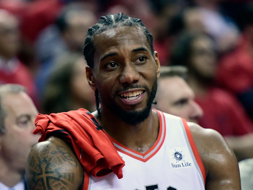 Toronto Raptors forward Kawhi Leonard (2) smiles from the bench during the second half of Game 4 of the NBA basketball playoffs Eastern Conference finals against the Milwaukee Bucks, Tuesday, May 21, 2019 in Toronto. (Frank Gunn/The Canadian Press via AP)