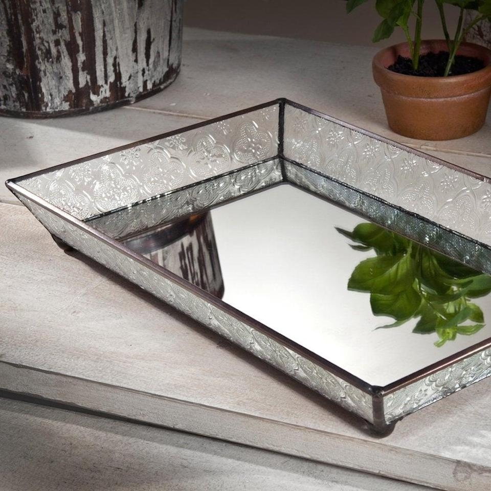 <p>This <span>J Devlin Vintage Glass Tray</span> ($40) features a mirrored bottom and can store everything from jewelry to makeup.</p>