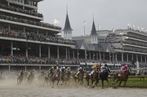 FILE - In this Saturday, May 4, 2019 file photo, Flavien Prat on Country House, third from right, races against Luis Saez on Maximum Security, right, during the 145th running of the Kentucky Derby horse race at Churchill Downs in Louisville, Ky. Maximum Security finished first but was disqualified. The fastest two minutes in sports will also be the quietest in Kentucky Derby history. Churchill Downs scraped plans earlier this month for 23,000 physically distanced, masked fans to attend Saturday's rescheduled Tripled Crown race due to the rise in coronavirus cases. It will be the first time spectators will not be allowed to attend the race.(AP Photo/Darron Cummings, File)