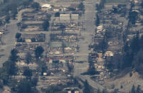 In this aerial photo taken from a helicopter, structures destroyed by wildfire are seen in Lytton, British Columbia, on Thursday, July 1, 2021. Lytton city council member Lilliane Graie, on behalf of Mayor Jan Polderman, said in an email Thursday that the fire had devastated the town, a village about 153 kilometers (95 miles) northeast of Vancouver. (Darryl Dyck/The Canadian Press via AP)