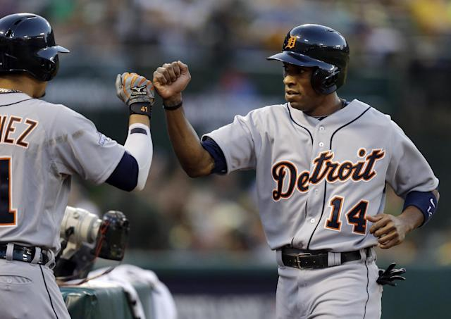 Detroit Tigers' Austin Jackson (14) gets congratulations in the dugout after scoring on a hit by Miguel Cabrera in the first inning of Game 1 of the American League baseball division series against the Oakland Athletics in Oakland, Calif., Friday, Oct. 4, 2013. (AP Photo/Ben Margot)
