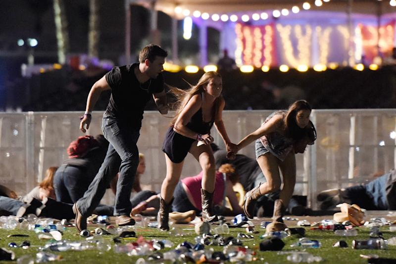 People run from the Route 91 Harvest country music festival afterhearing gun fire.