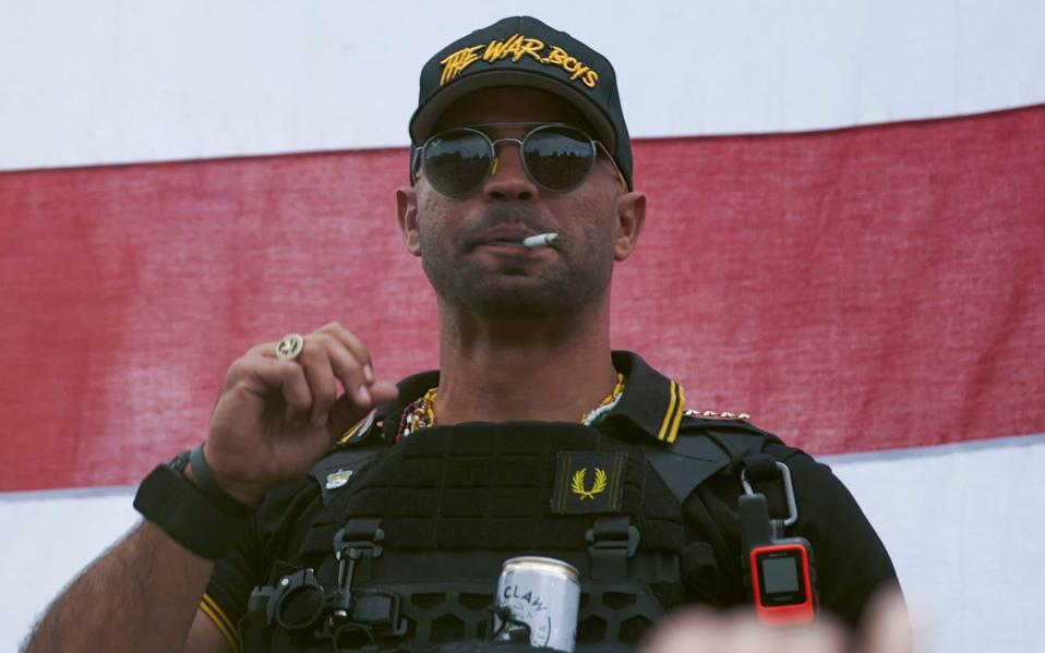 """Proud Boys leader Henry """"Enrique"""" Tarrio wears a hat that says The War Boys during a rally in Portland on January 4"""