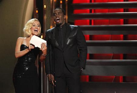 "Kellie Pickler and Sean ""Diddy"" Combs present the award for vocal group of the year at the 47th Country Music Association Awards in Nashville, Tennessee November 6, 2013. REUTERS/Harrison McClary"