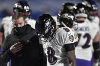 Baltimore Ravens quarterback Lamar Jackson (8) is helped off the field after he was injured during the second half of an NFL divisional round football game against the Buffalo Bills Saturday, Jan. 16, 2021, in Orchard Park, N.Y. (AP Photo/Adrian Kraus)