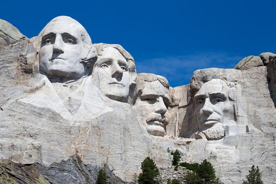 "<p>The giant faces of George Washington, Thomas Jefferson, Theodore Roosevelt, and Abraham Lincoln peer down from <a href=""https://www.nps.gov/moru/index.htm"" rel=""nofollow noopener"" target=""_blank"" data-ylk=""slk:Mount Rushmore"" class=""link rapid-noclick-resp"">Mount Rushmore</a> making this a sight to see. </p>"