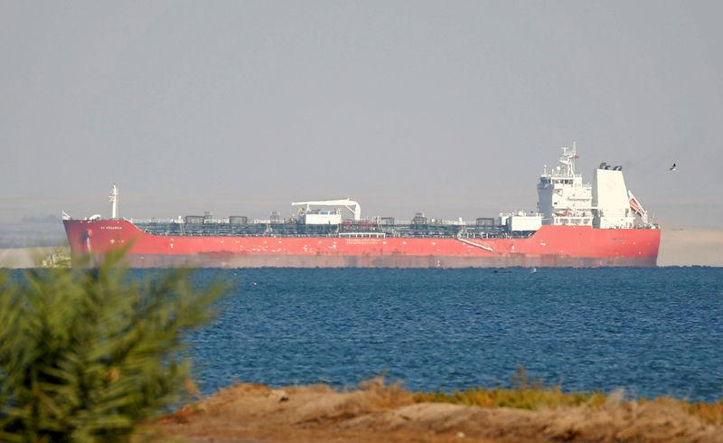 FILE PHOTO: A container ship crosses the Gulf of Suez towards the Red Sea before entering the Suez Canal