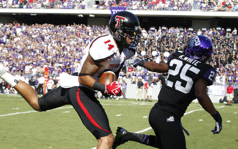 Texas Tech wide receiver Darrin Moore (14) pulls in a touchdown pass against TCU cornerback Kevin White (25) during the first half of an NCAA college football game, Saturday, Oct. 20, 2012, in Fort Worth, Texas. (AP Photo/LM Otero)