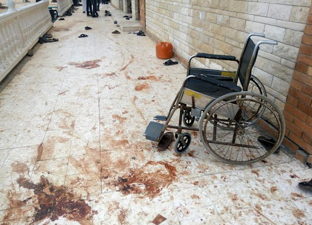 <p>A wheelchair is seen near blood stains of victims after an explosion at Al Rawdah mosque in Bir Al-Abed, Egypt, Nov. 25, 2017. (Photo: Mohamed Soliman/Reuters) </p>