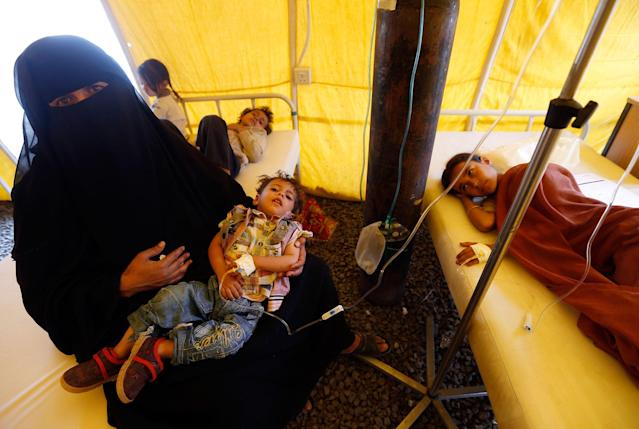 <p>Yemeni children suspected of being infected with cholera receive treatment at a makeshift hospital in Sana'a on June 5, 2017.<br> Yemen is descending into total collapse, its people facing war, famine and a deadly outbreak of cholera, as the world watches, the UN aid chief said. (AFP/Getty Images) </p>