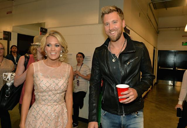 NASHVILLE, TN - JUNE 05: Carrie Underwood and Charles Kelley attend the 2013 CMT Music awards at the Bridgestone Arena on June 5, 2013 in Nashville, Tennessee. (Photo by Rick Diamond/Getty Images)