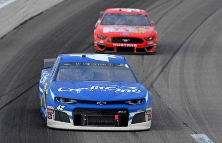 May 11, 2019; Kansas City, KS, USA; NASCAR Cup Series driver Kyle Larson (42) leads Daniel Suarez (41) during the Digital Ally 400 at Kansas Speedway. Mandatory Credit: Jasen Vinlove-USA TODAY Sports