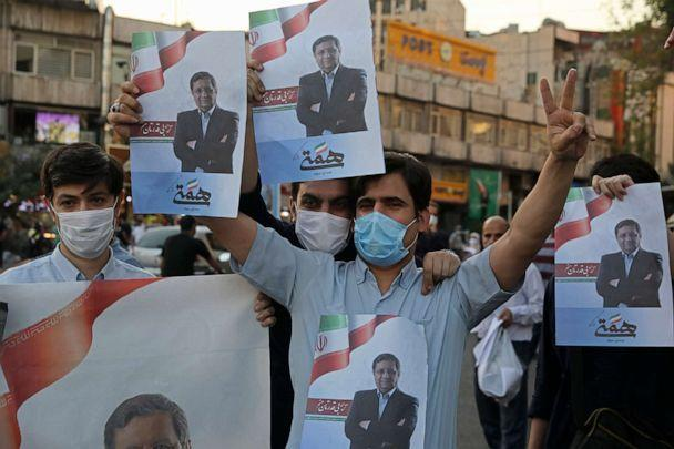 PHOTO: Supporters of Abdolnasser Hemmati, a presidential candidate in the June 18, elections, hold signs with his picture, during a street rally in Tehran, Iran, Tuesday, June 15, 2021.  (Vahid Salemi/AP)