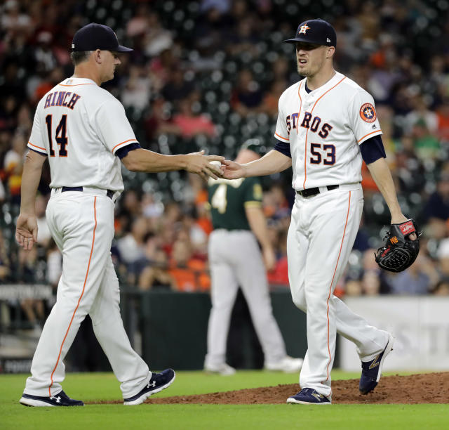 Houston Astros manager AJ Hinch (14) pulls relief pitcher Ken Giles (53) from the baseball game during the ninth inning against the Oakland Athletics on Tuesday, July 10, 2018, in Houston. (AP Photo/David J. Phillip)