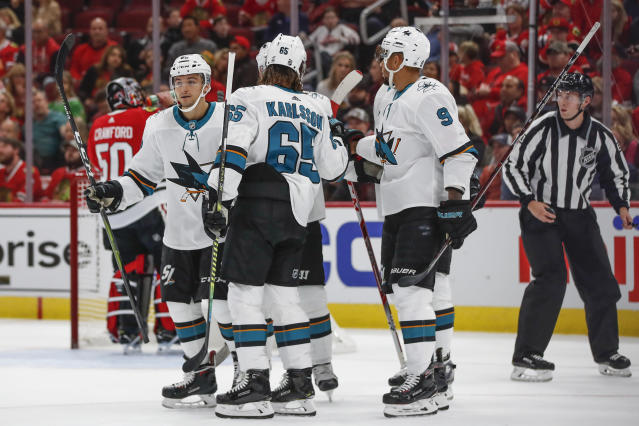 San Jose Sharks right wing Kevin Labanc, left, celebrates with teammates after scoring against the Chicago Blackhawks during the first period of an NHL hockey game Thursday, Oct. 10, 2019, in Chicago. (AP Photo/Kamil Krzaczynski)