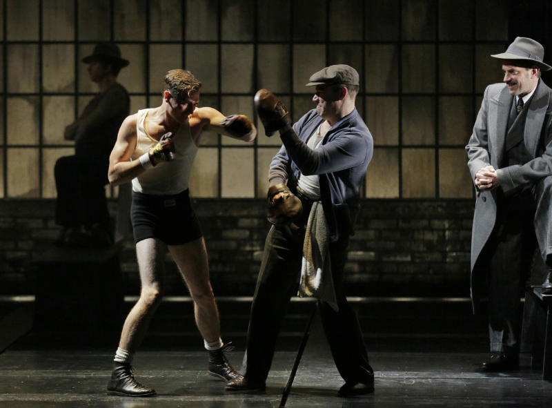 """This theater image released by Lincoln Center Theater shows, from left, Seth Numrich, Danny Burstein and Danny Mastrogiorgio in """"Golden Boy."""" (AP Photo/Lincoln Center Theater, Paul Kolnik)"""