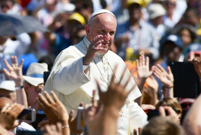 Pope Francis waves at the end of the canonisation mass of Mother Teresa in St Peter's square (AFP Photo/Vincenzo Pinto)