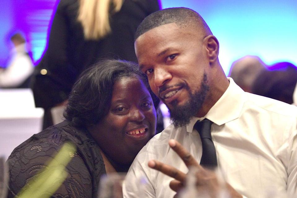 DeOndra Dixon with Jamie Foxx at the Global Down Syndrome Foundation's 9th annual Be Beautiful Be Yourself Fashion Show at Sheraton Denver Downtown Hotel on November 11, 2017 in Denver, Colorado. (Photo by Tom Cooper/Getty Images for Be Beautiful Be Yourself Fashion Show)