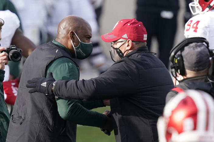 Michigan State head coach Mel Tucker, left, greets Indiana head coach Tom Allen after the NCAA college football game, Saturday, Nov. 14, 2020, in East Lansing, Mich. Indiana won 24-0. (AP Photo/Carlos Osorio)