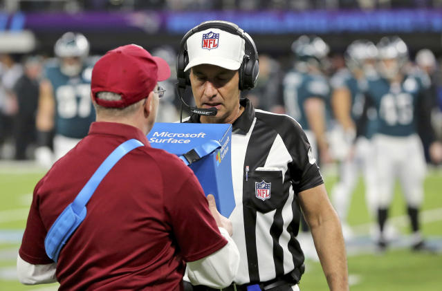 FILE - In this Feb. 4, 2018, file photo, referee Gene Steratore reviews a touchdown reception by Philadelphia Eagles' Corey Clement touchdown during NFL football's Super Bowl 52 against the New England Patriots in Minneapolis. The NFL's catch rule would get less complicated if team owners approve recommendations from the powerful competition committee, when the league's annual meetings begin on Monday in Orlando, Fla. (AP Photo/Gregory Payan)