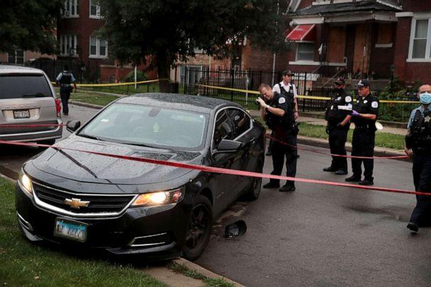 PHOTO: Police investigate the scene of a shooting in the Auburn Gresham neighborhood on July 21, 2020 in Chicago. (Scott Olson/Getty Images)