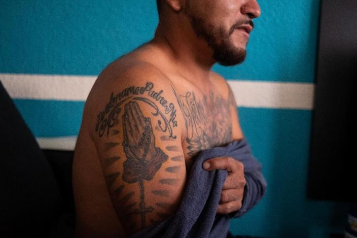 "Pedro Carrizales says that like the mythical phoenix inked on his chest, ""I was reborn from my ashes to save other gang-bangers"" (AFP Photo/MAURICIO PALOS)"