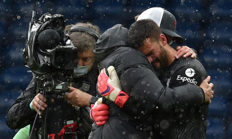 Alisson hugs Liverpool's manager Jürgen Klopp after the final whistle.