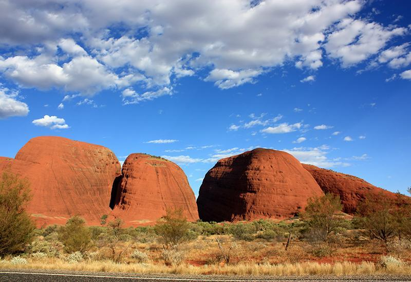 <p>No journey to Uluru-Kata Tjuta National Park is complete without a visit to Kata Tjuta - or 'the Olgas.' This unique formation of domed rocks huddled together - there are 36 boulders in total - is around 35km west of Uluru. The tallest rock is approximately 200m higher than Uluru and combined they form deep valleys and steep gorges. The 7.4km Valley of the Winds loop is a great bush walk that cuts through the winding gorges. It takes 2-4 hours, depending on your fitness level.</p>