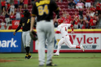Cincinnati Reds' Jose Iglesias (4) runs home to score on a grand slam off Pittsburgh Pirates relief pitcher Montana DuRapau in the second inning of a baseball game, Monday, July 29, 2019, in Cincinnati. (AP Photo/John Minchillo)